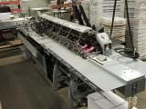 a photo of HM Surchin Company Six Station Turn Over Open Feed Station Conveyor #2 - Kennesaw, GA - Click for Video!