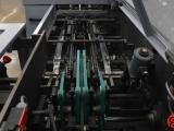 2001 Heidelberg Stitchmaster ST 100 Automatic Saddle Stitcher w/ 6 Pockets, Cover Feeder, Three Knife Trimmer, and Hand Feed Station - Click for Video!