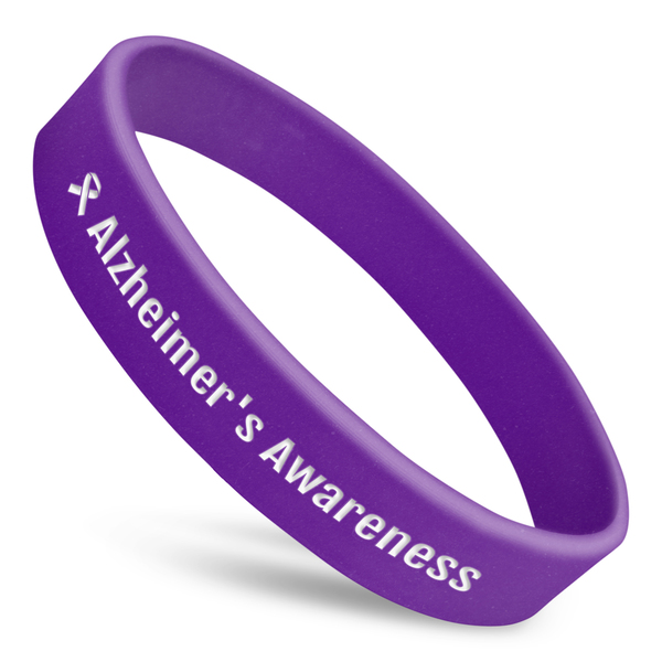 Alzheimer's Awareness silicone wristband in purple with white writing and ribbon