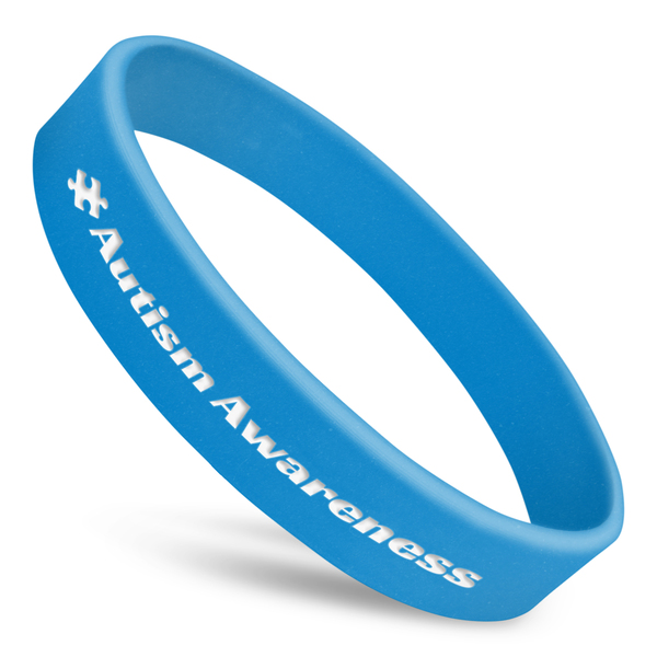 autism awareness wristband in blue silicone with white ink and puzzle piece