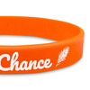 close up of orange flat classic wristband with white text