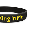 close up of black classic wristband with yellow text