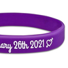 close up of purple silicone wristband with white text