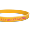 close up of yellow ultra thin wristband with pink ink filled text
