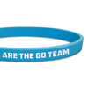 close up of blue ultra thin wristband with white text