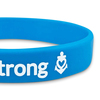 close up of blue super rush wristband with white print ink