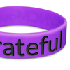close up of wide purple wristband with black ink fill