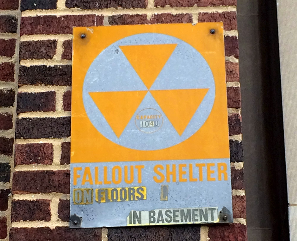 Fallout shelter sign posted at 3500 Howard St, Skokie, Illinois. (WBEZ/Chris Bentley)