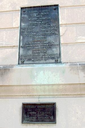 Dueling plaques on the Clark Street Bridge