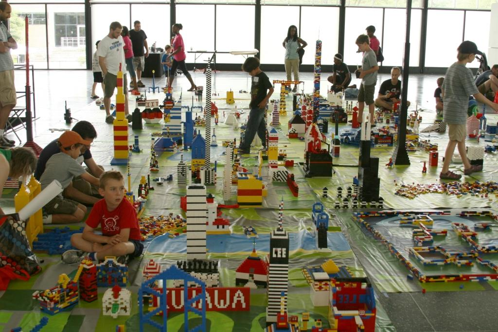 Children and adults alike build a city out of Legos in IIT's Crown Hall in 2011. The city will be built anew this weekend. (Courtesy of the Mies van der Rohe Society)