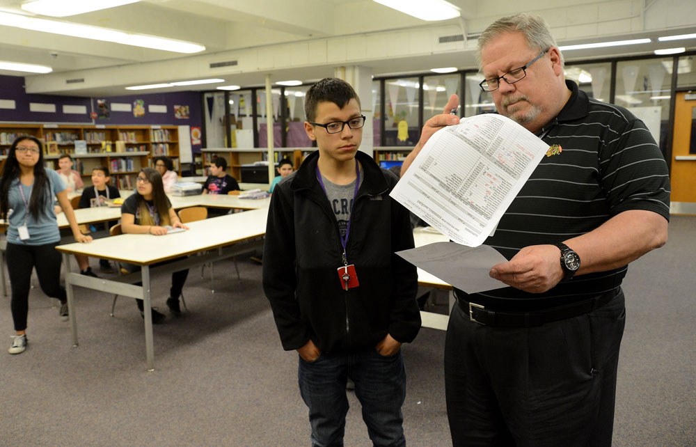 Asst. Principal David Harshbarger with 7th grader Jose Huerta during a required after school homework session at Tefft Middle School in Streamwood. Experts say that affluent parents now spend 0,000 per child per year on enrichment for their children—everything from music lessons to summer camps to private tutoring.  That's increased the burden on schools to keep low-income kids learning at the same pace. (The Daily Herald/Bob Chwedyk)