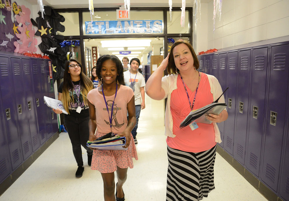 Language arts instructor Jamie Reyes leads her group to a required after school homework session at Tefft Middle School in Streamwood. Some people, including Illinois' new superintendent of education, say the state must improve schools but must also attack childhood poverty more directly to see better school performance.  (The Daily Herald/Bob Chwedyk)