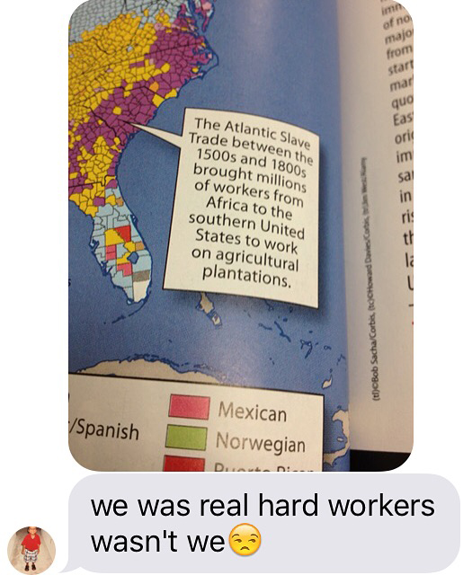 """High school freshman Coby Burren texted his mom this image of his world geography book that calls slaves """"workers."""" (Courtesy of Roni Dean-Burren via Houston Public Media)"""