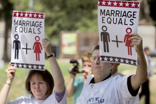 File: From left, Martha and Stan Harper hold signs in support of the National Organization for Marriage on Aug. 10, 2010 in Raleigh, North Carolina. (AP)