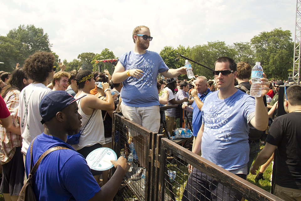 Festival volunteers hand out water bottles on Sunday. (WBEZ/Andrew Gill)