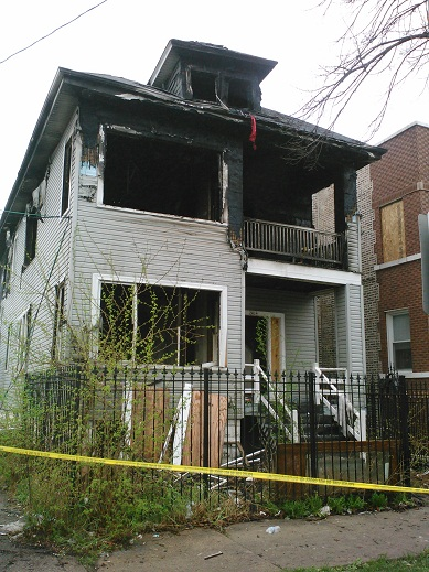 Fire destroyed this house at 2414 N. Marmora, killing two people inside (photo/Northwest Side Housing Center)