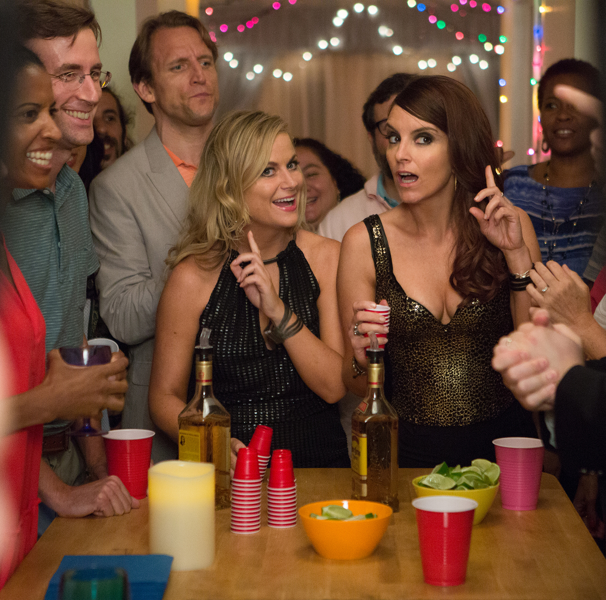 In 'Sisters,' Amy Poehler and Tina Fey come home to clean out their childhood bedroom before the family house is sold. They decide to throw one last party for their high school classmates. (K. C. Bailey/2015 Universal Studios)