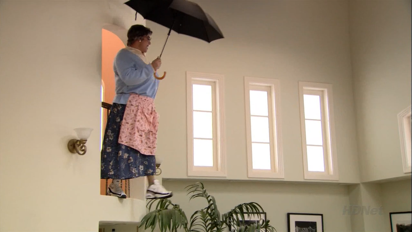 Mrs. Featherbottom attempts to fly on an umbrella in 'Meat the Veals,' one of the classic program's all-time great episodes. (Still from Arrested Development)