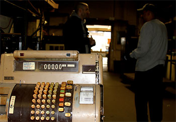 After 120 years in business, the A.J. Thomas Midwest Cash Register Company in Chicago's West Loop is closing. (Tricia Bobeda/WBEZ)