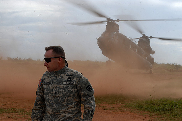 Lt. Col. Michael Cortez, Commander, 21st Theater Sustainment Command Special Troops Battalion, braces for the down draft from a landing CH-47 Chinook, Kitgum, Uganda, Oct. 16, 2009. (Flickr/US Army Africa)