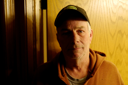 Jon Jelinek standing in front of the bedroom where he found his son dead of a heroin overdose. (WBEZ/Rob Wildeboer)