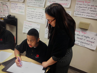Teacher Jennifer Bahns helps her seventh-graders work through algebraic equations that, before the Common Core, were taught in eighth or ninth grade. (Erin Einhorn/Hechinger Report)