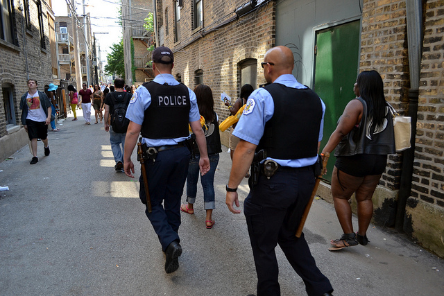 Chicago Police patrol a Lakeview alley after the parade. (Flickr/nathanmac87)