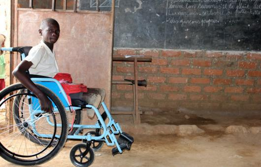 A 15-year old in the Democratic Republic of Congo with his new wheelchair.