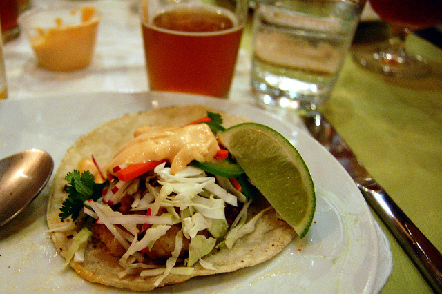 Pan-fried walleye fish taco with pickled carrot, shaved cabbage, radish, cilantro and Sriracha aioli (WBEZ/Louisa Chu)