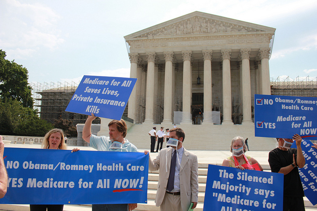 Protesters outside the Supreme Court as the ACA ruling came down Thursday morning. (Flickr/Talk Radio News Service)