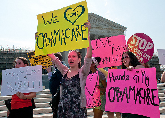 A scene from the Supreme Court following their ruling to uphold the ACA. (Flickr/SEIU International)