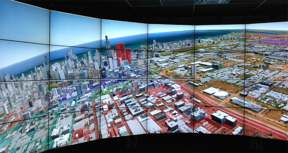 Google Earth is shown in EVL's CAVE2™ Hybrid Reality Environment. CAVE2 is a trademark of the University of Illinois Board of Trustees. The system is being used by the city of Chicago to better help visualize massive amounts of data in a project dubbed Project Batman. (Image courtesy of the Electronic Visualization Laboratory EVL at the University of Illinois at Chicago)