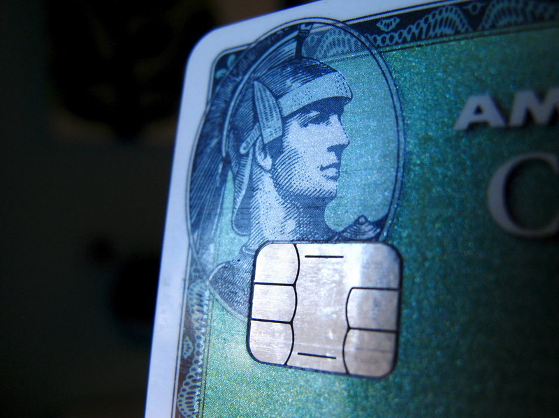 A computer chip is seen on a newly issued credit card in this photo illustration taken in Encinitas, Calif., this week. In an effort to reduce counterfeit and credit card fraud, more than 200 million payment cards have been issued with embedded computer chips in the U.S., ahead of a Oct. 1 deadline for the switch to such cards, according to the Smart Card Alliance. (Mike Blake/Reuters/Landov)