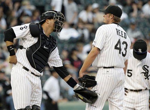 Sox catcher AJ Pierzynski talks to Addison Reed on the mound. (AP/Nam Y. Huh)