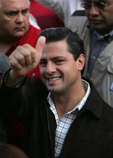 In this photo from July 3, 2005, Enrique Pena Nieto, then candidate of the Institutional Revolutionary Party, for governor of the state of Mexico, gives the thumbs up sign as he arrives at a voting station to cast his vote in the city of Atlacomulco, Mexico. (AP/Dario Lopez-Mills)