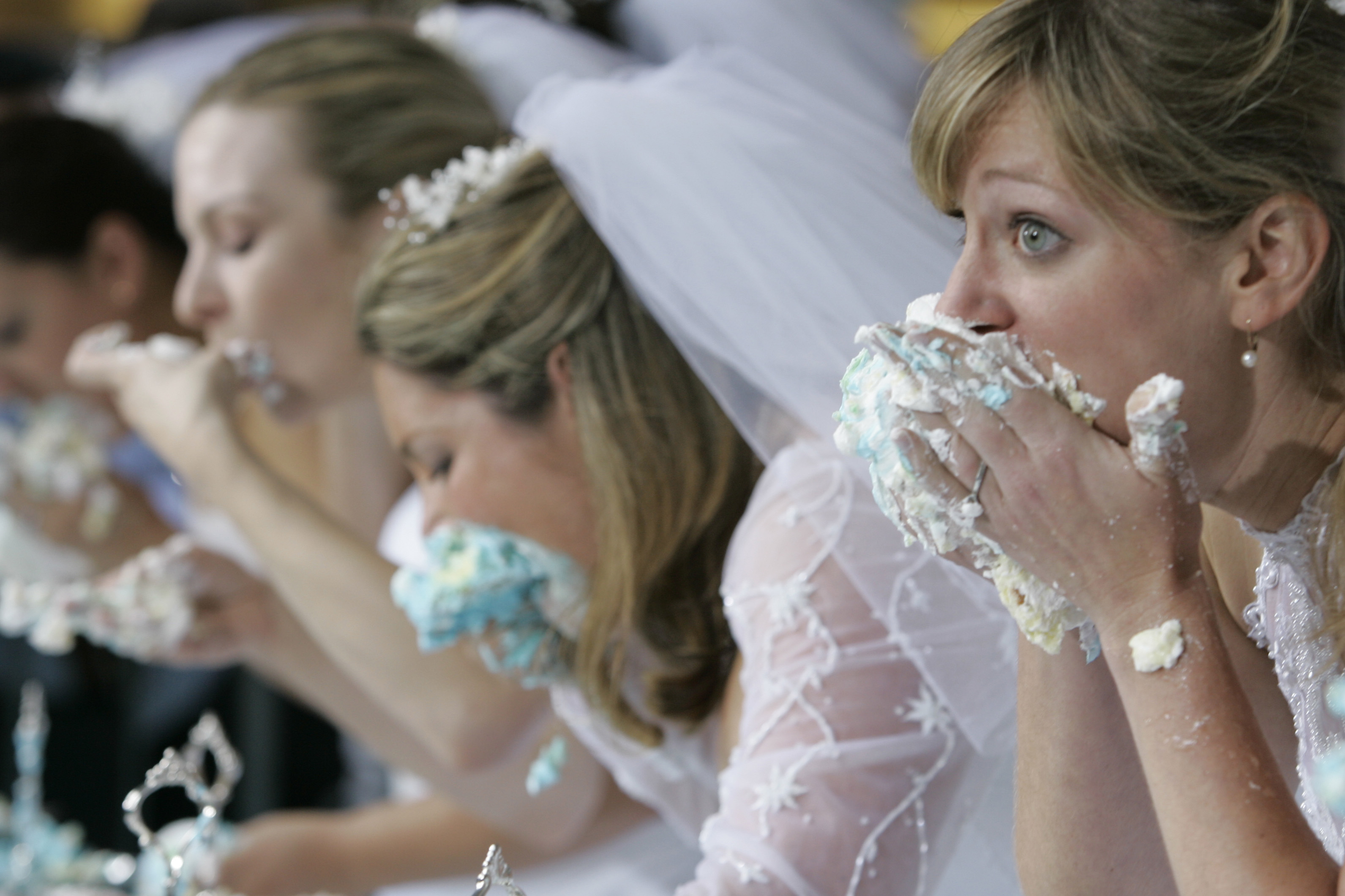 Contestants face off in WE TV's cake eating contest in June of 2007. The 15 brides faced off in Times Square for a grand prize of $25,000 to kick off the fourth season of the cable channel's 'Bridezillas' series. (AP/Mary Altaffer)
