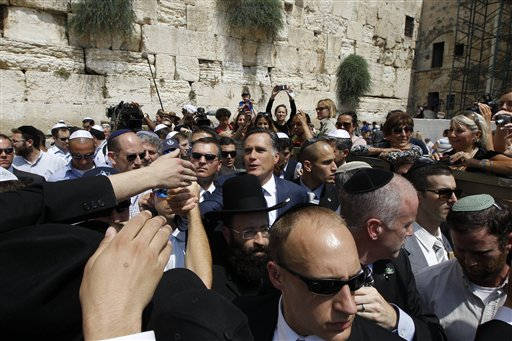 Republican presidential candidate Mitt Romney greets the crowd after visiting the Western Wall in Jerusalem Sunday. (AP/Charles Dharapak)