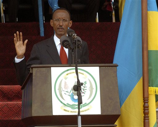 The president of Rwanda Paul Kagame, raises his hand as he takes oath of office , during his inauguration in Kigali, Rwanda, Monday, Sept. 6, 2010.  (AP/John Liebenberg)