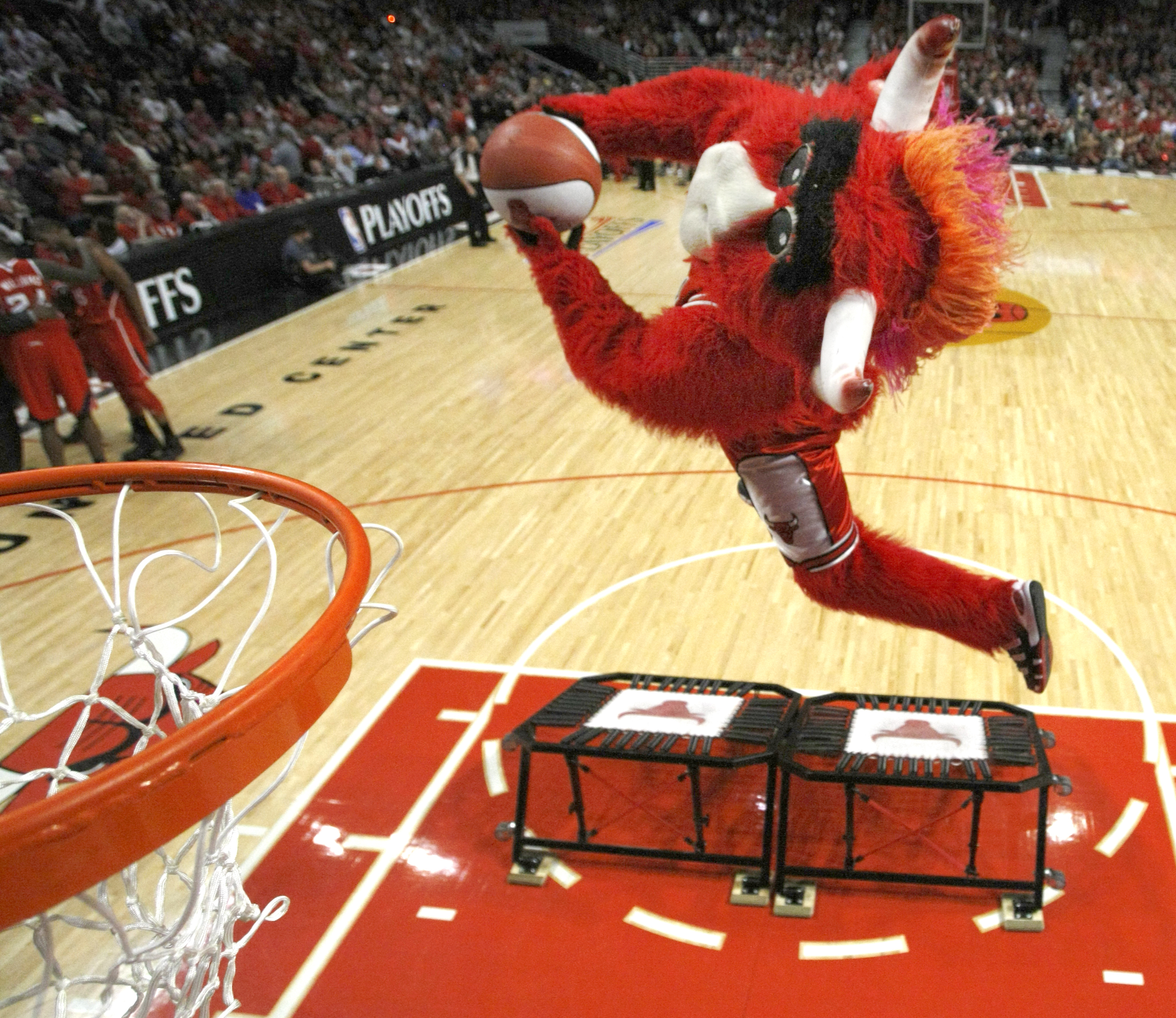 A dunk from Benny the Bull, the Chicago team's mascot. (AP/Charles Rex Abrogast)