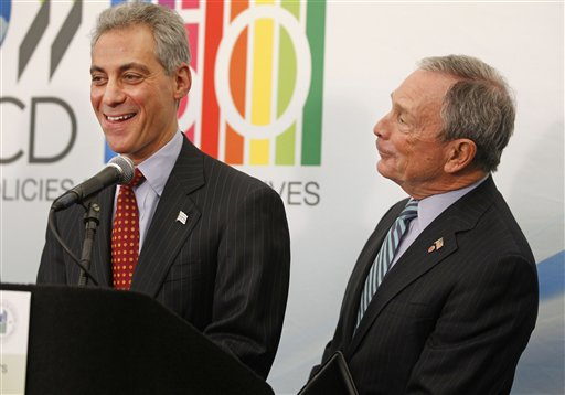 Chicago Major Rahm Emanuel and New York Mayor Michael Bloomberg joke in March 2011; Bloomberg was in town for a meeting of the Organization for Economic Co-operation and Development. (AP/Spencer M. Green)