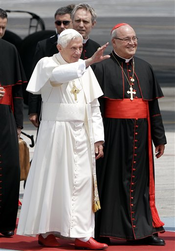Pope Benedict XVI walks with Cuba's Cardinal Jaime Ortega, right, as he waves upon his arrival in Havana in late March. (AP/Franklin Reyes)
