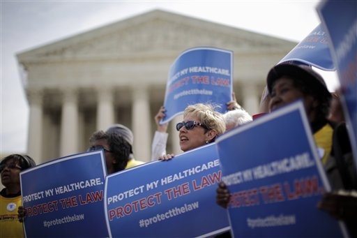 Pro-Affordable Care Act protesters rally outside the Supreme Court (AP)