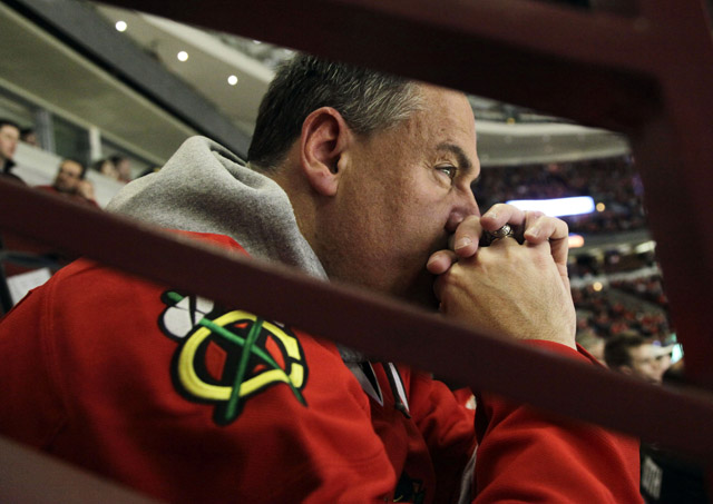 A Blackhawks fan reacts as he watches his team play against the Phoenix Coyotes during Game 6 of the first-round playoffs. The Coyotes won 4-0. (AP/Nam Y. Huh)