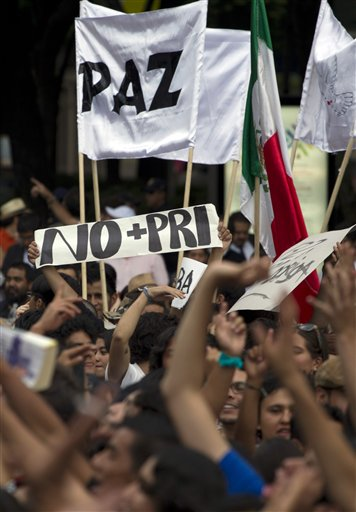 Students demonstrate during a protest against a possible return of the old ruling Institutional Revolutionary Party, PRI, in Mexico City last Wednesday. Mexico will hold presidential elections on July 1. (AP/Eduardo Verdugo)