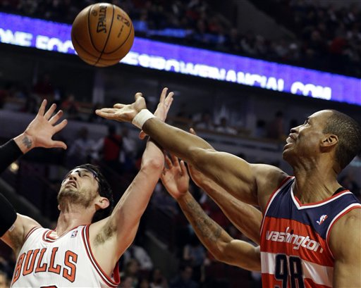 File: In this April 17, 2013 file photo, Washington Wizards center Jason Collins, right, battles for a rebound against Chicago Bulls guard Kirk Hinrich.
