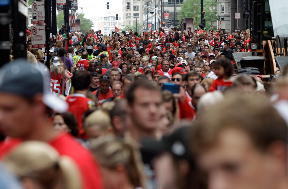 Chicago Blackhawks fans pack downtown streets after the Blackhawks players rode on double-decker buses in a parade to celebrate the NHL hockey club's Stanley Cup championship,Thursday, June 18, 2015, in Chicago. (AP Photo/Kiichiro Sato)