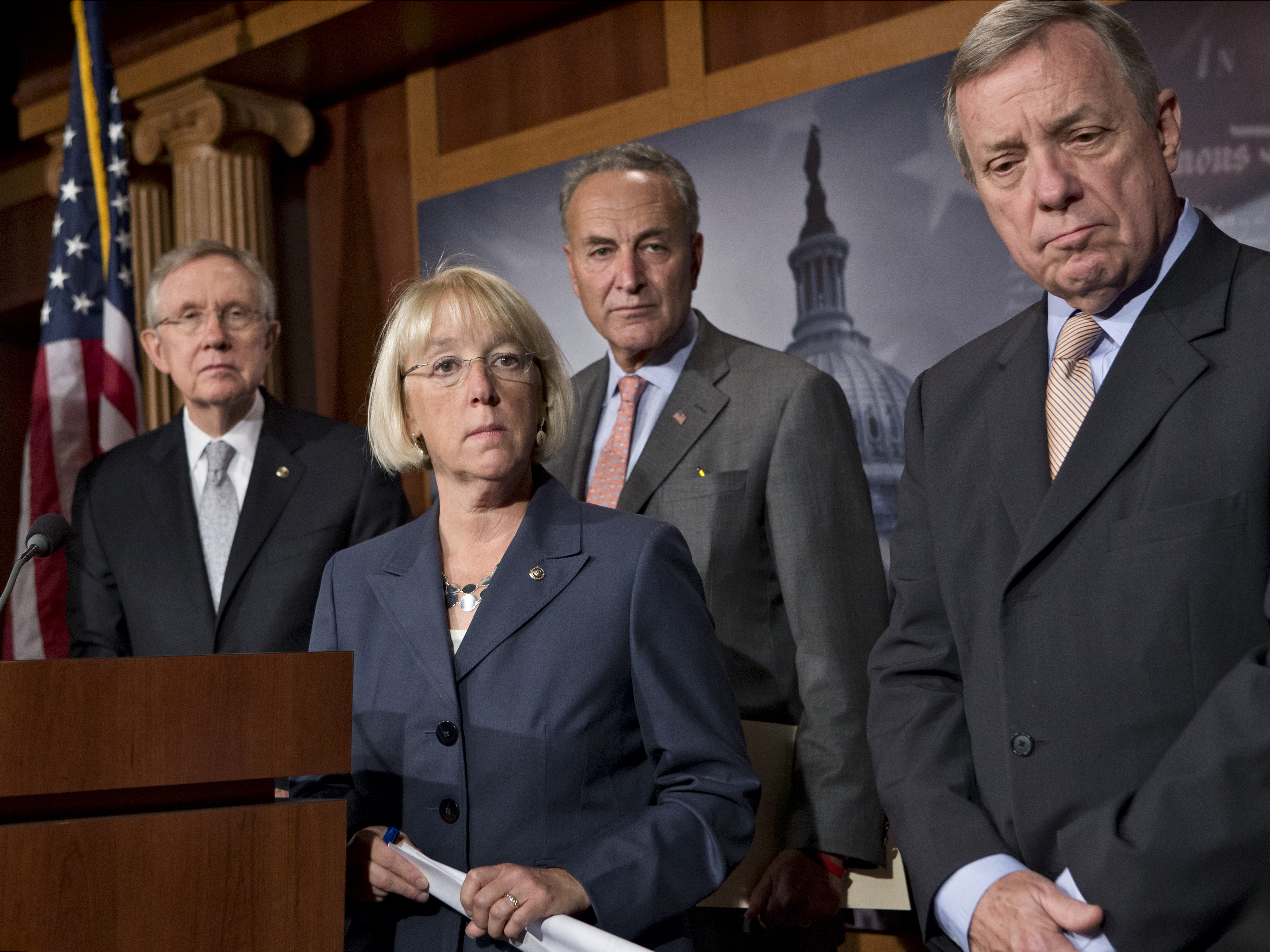 From left, Senate Majority Leader Harry Reid, D-Nev., Sen. Patty Murray, D-Wash., Sen. Charles Schumer, D-N.Y., and Sen. Dick Durbin, D-Ill., take questions at a news conference. (AP/J. Scott Applewhite)