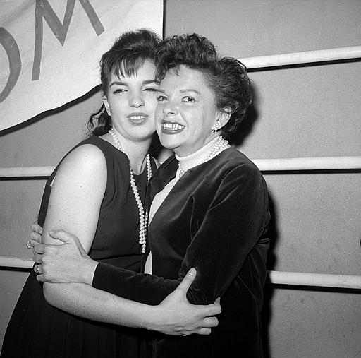 Judy Garland hugs her 17-year-old daughter Liza Minnelli after watching Liza star in the Off-Broadway revival of the 1941 musical