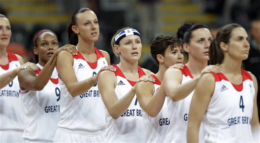 Great Britain women's basketball team members join together for the national anthems before a preliminary women's basketball game against Canada at the 2012 Summer Olympics, Monday, July 30, 2012, in London. (AP/Eric Gay)