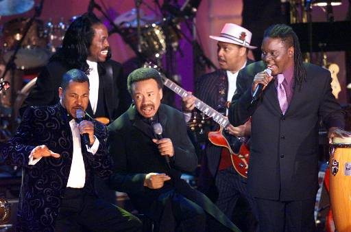 Members of Earth, Wind & Fire surround the band's leader and founder Maurice White, center. The band, which rose to prominence in the Seventies, solidified the growth of black album music as it brought together the earlier sounds of jazz, blues, R&B, pop, gospel, funk and deep soul. (AP Photo/Kathy Willens)